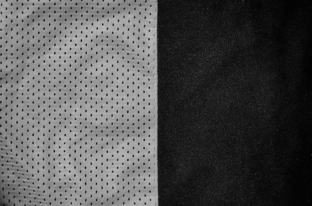Fundo cinzento da textura da tela da roupa do esporte.
