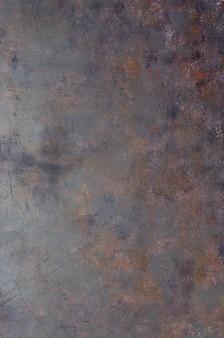 Fundo cinzento-oxidado velho gasto do metal com textura.