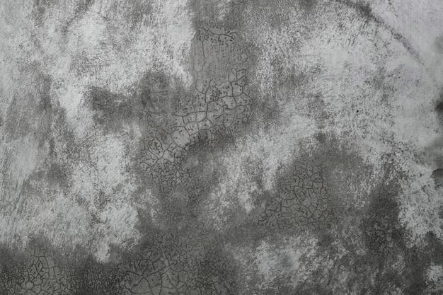 Fundo cinzento simples da textura do muro de cimento.