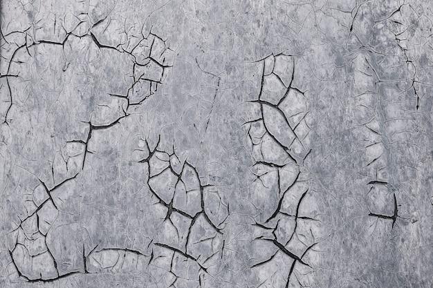 Fundo cinzento velho com rachaduras, textura