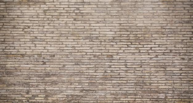 Fundo cinzento velho da textura da parede de tijolo.