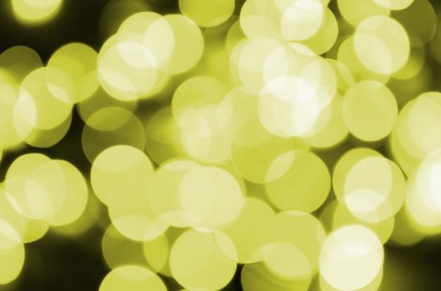 Fundo claro defocused amarelo dourado do efeito de bokeh.
