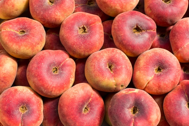 Fundo colorido abstrato da textura do teste padrão da fruta fresca do pêssego
