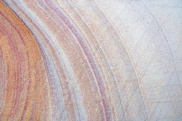 Fundo colorido bonito da textura da parede de pedra da areia.