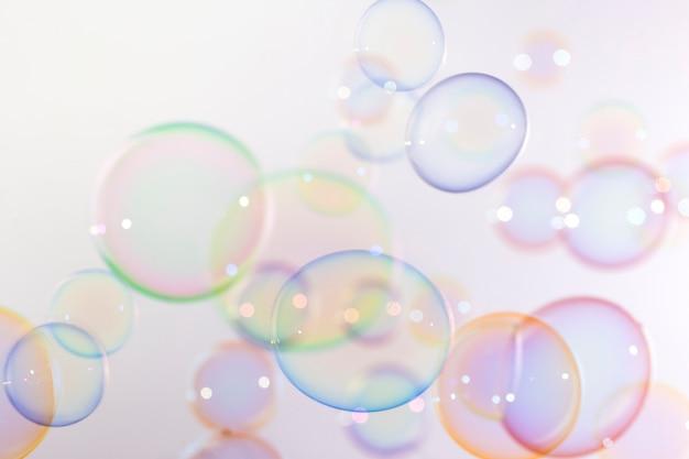 Fundo colorido bonito das bolhas de sabão.