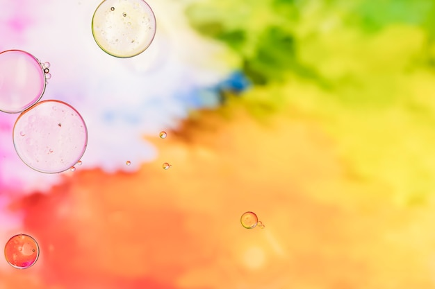 Fundo colorido com bolhas transparentes