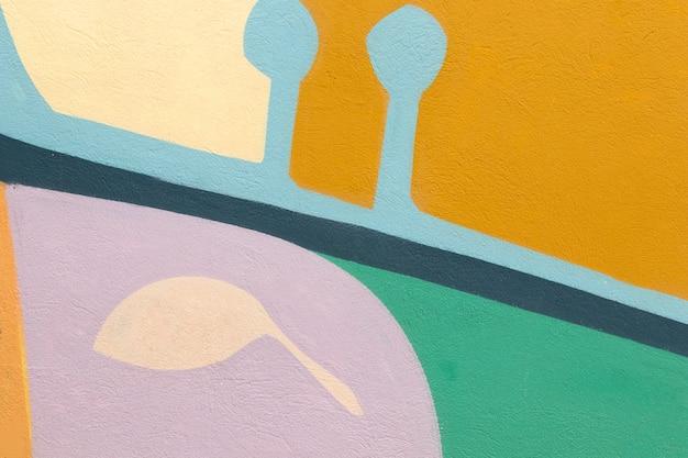 Fundo colorido da parede com formas abstratas Foto gratuita