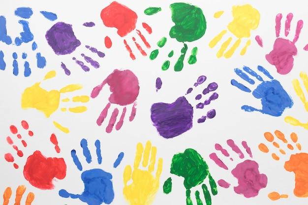 Fundo colorido das mãos da vista superior