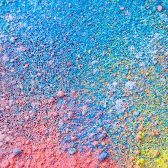 Fundo colorido de pó de giz. partículas de poeira multicoloridas se espalharam.