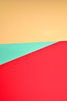Fundo colorido laranja, vermelho e verde. espaço para texto ou desenho.
