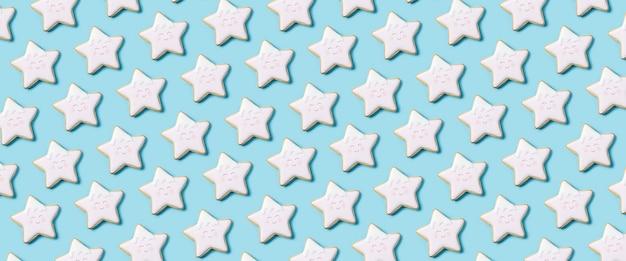 Fundo com biscoitos na forma de uma estrela de cima com bandeira de confeiteiro