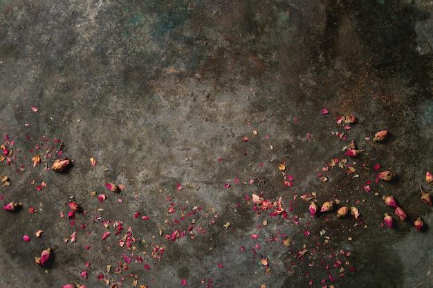 Fundo com botões de rosa secos