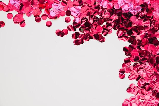 Fundo com confete brilhante rosa