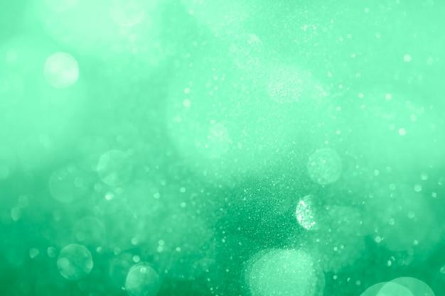 Fundo com padrão bokeh verde turquesa