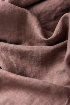 Fundo com tecido de linho marrom, imagem vista de cima para baixo