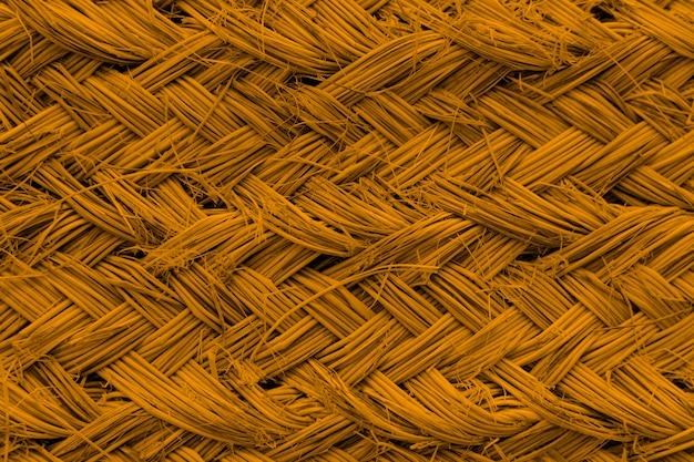 Fundo com textura de vime âmbar brilhante