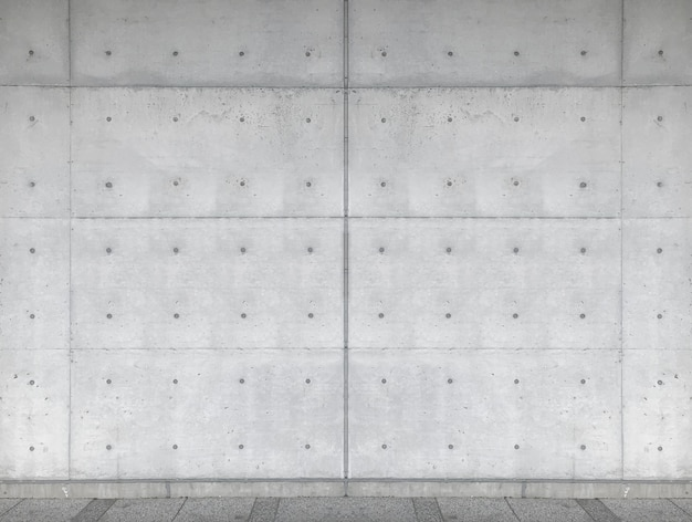 Fundo concreto envelhecido da parede da cerca do cimento.