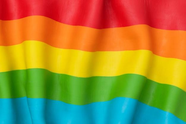 Fundo da bandeira do arco-íris lgbtq + em textura de argila plasticina diy
