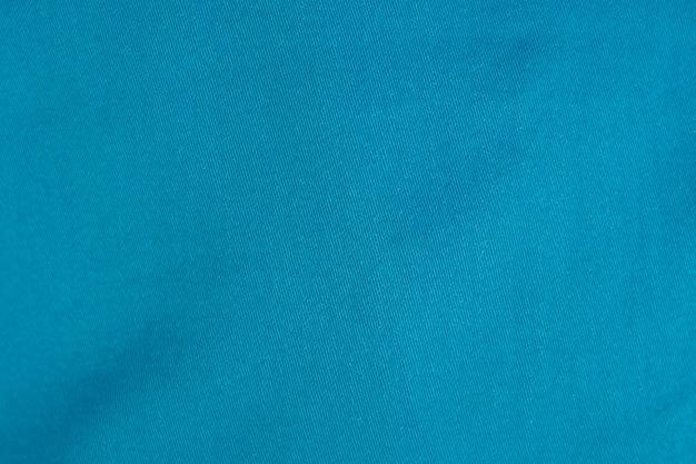 Fundo da luz - textura azul de brim da sarja de nimes.