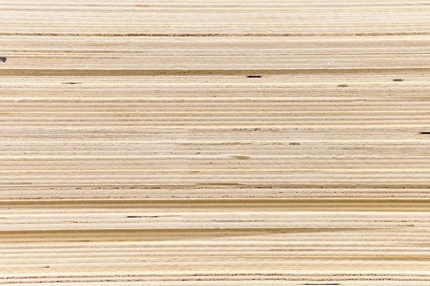 Fundo da madeira compensada do material de construção, textura.