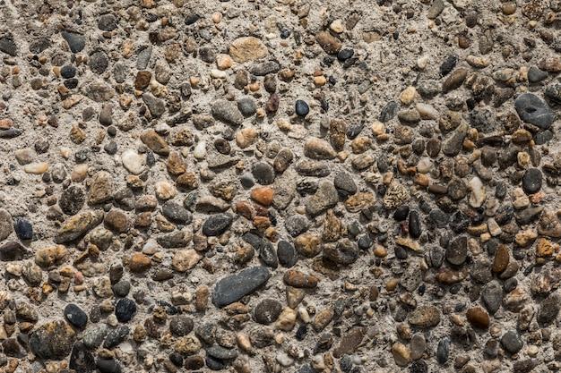 Fundo da natureza - pequenos seixos em concreto. textura de pedras minúsculas.