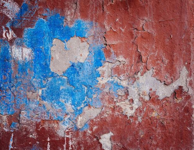 Fundo da parede colorida velha da pintura da casca