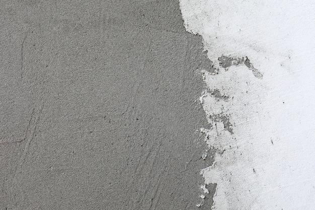 Fundo da parede de estuque branco. textura de parede de cimento pintado de branco. nitidez em todo o quadro