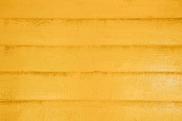 Fundo da parede de madeira ou textura amarela