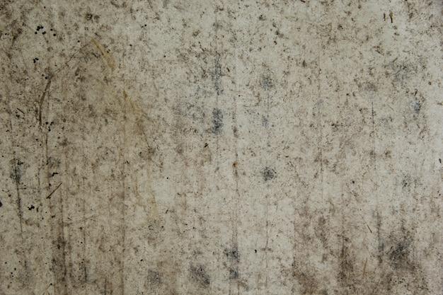 Fundo da parede de papel ou piso de cimento velho e mancha