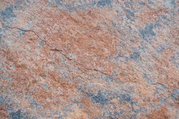 Fundo da parede de pedra marrom e azul