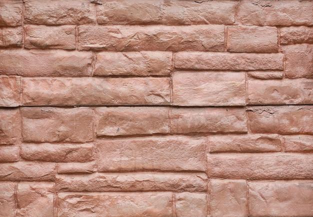 Fundo da parede de pedra vermelha abstrata