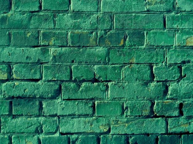 Fundo da parede de textura de tijolo verde.