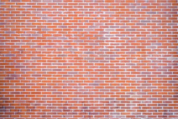 Fundo da parede de tijolo de tom laranja