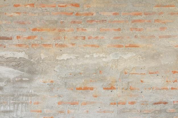 Fundo da parede de tijolo e revestimento concreto.