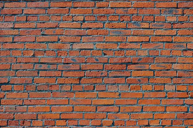Fundo da parede de tijolo. linhas suaves de alvenaria vermelha.