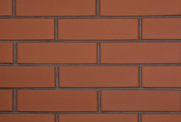 Fundo da parede de tijolo marrom nova. abstrato.