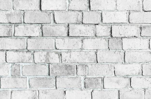Fundo da parede de tijolo texturizado branco