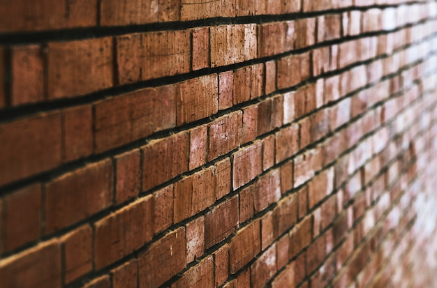 Fundo da parede de tijolo vermelho marrom