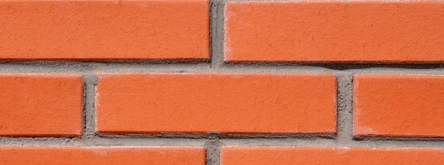 Fundo da parede de tijolo vermelho para o projeto. tijolos são ligados por argamassa de cimento.