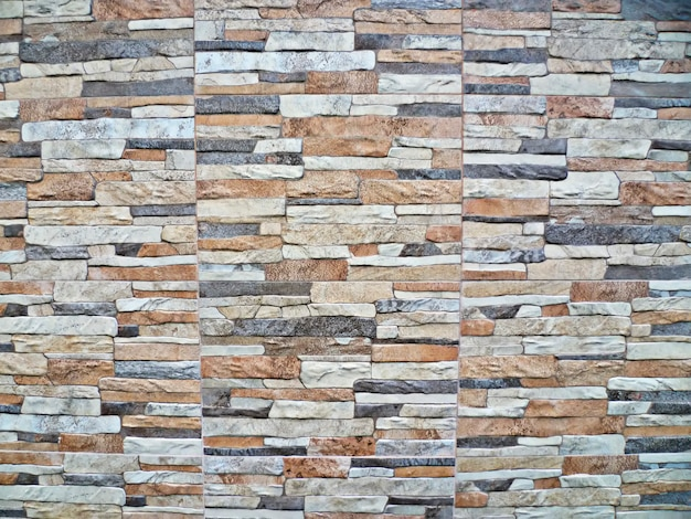 Fundo da parede de tijolos de várias texturas e cores
