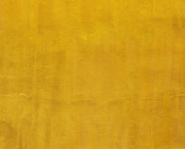 Fundo da parede do cimento da pintura do ouro para o projeto.