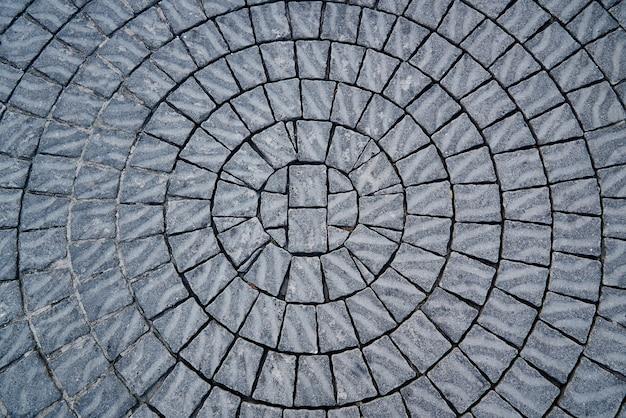 Fundo da pedra de pavimentação apresentado em um círculo.