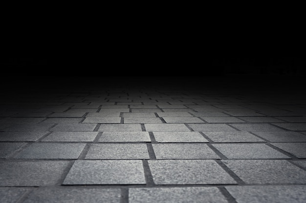 Fundo da perspectiva da textura do assoalho do tijolo do pavimento para a exposição ou a montagem do produto