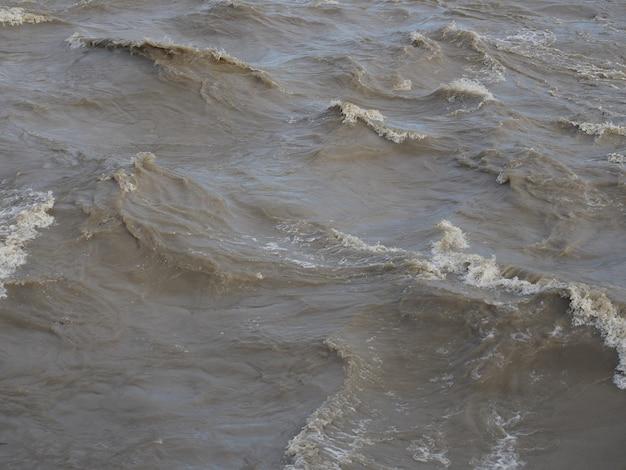 Fundo da superfície da água lamacenta