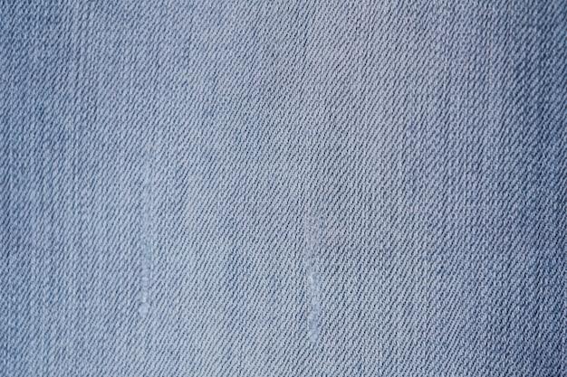 Fundo da textura azul de brim da sarja de nimes.