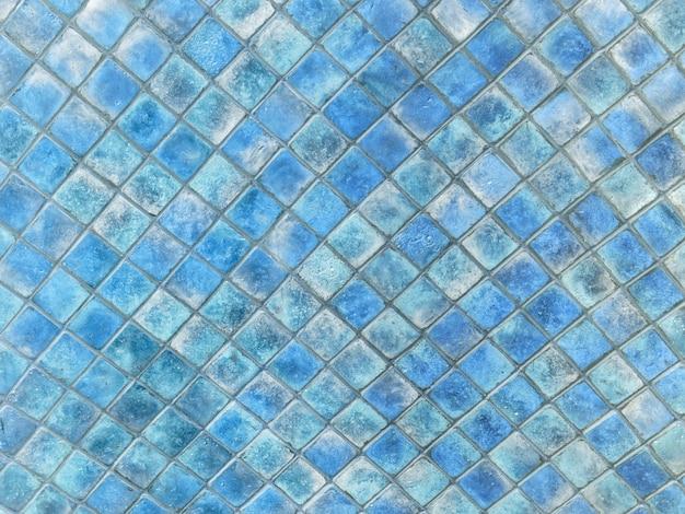 Fundo da textura do azulejo quadrado pequeno. diferentes tons de cor azul