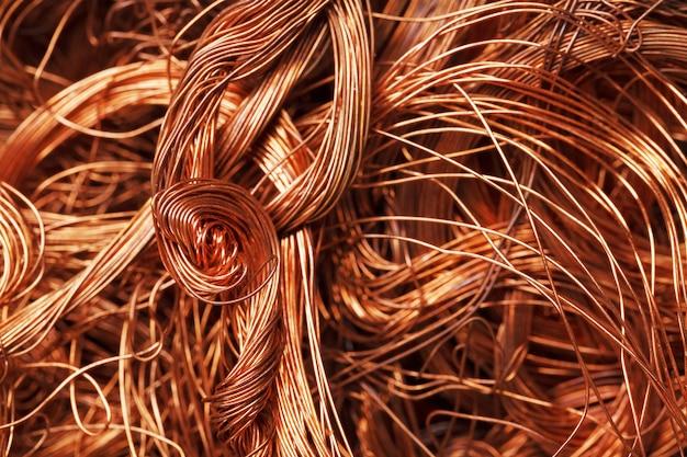 Fundo da textura do fio de cobre em tela cheia. sucata de metais não ferrosos.