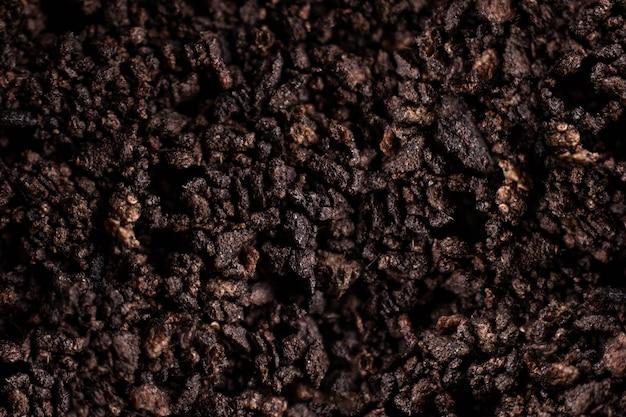 Fundo da textura do solo de brown escuro. closeup tiro macro