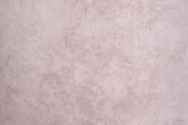 Fundo da textura gessada com cor rosa efeito mármore. fundo artístico feito à mão