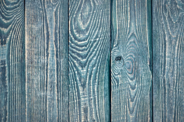 Fundo das placas de madeira da textura do vintage com os restos da pintura velha. vertical.